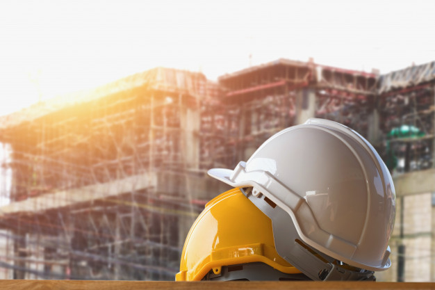 yellow-and-white-helmet-safety-in-construction-site_34152-6